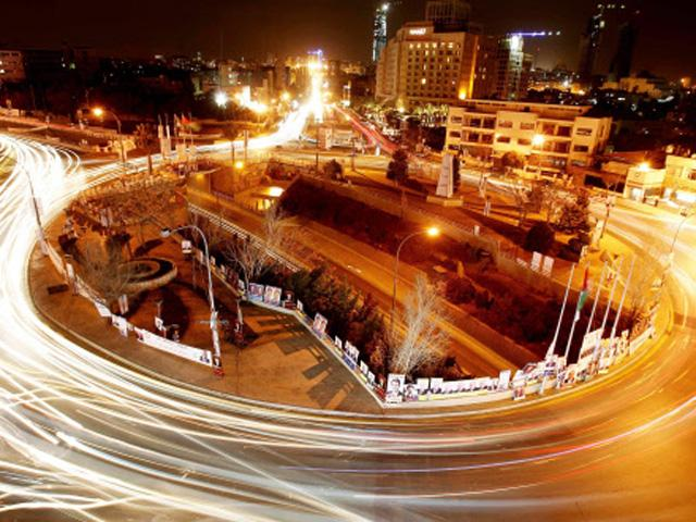 cars-drive-past-a-roundabout-in-amman-jordan
